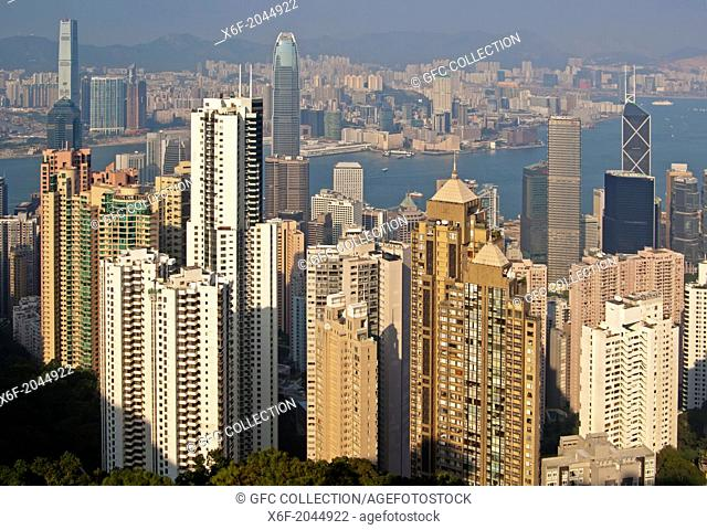 View across the skyscrapers in Central District and the Victoria Harbour to Kowloon, Hong Kong
