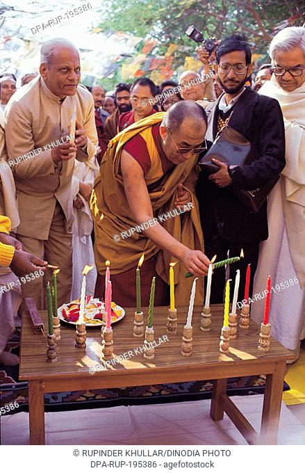 Dalai lama lighting candle mcleodganj, himachal pradesh, india, asia