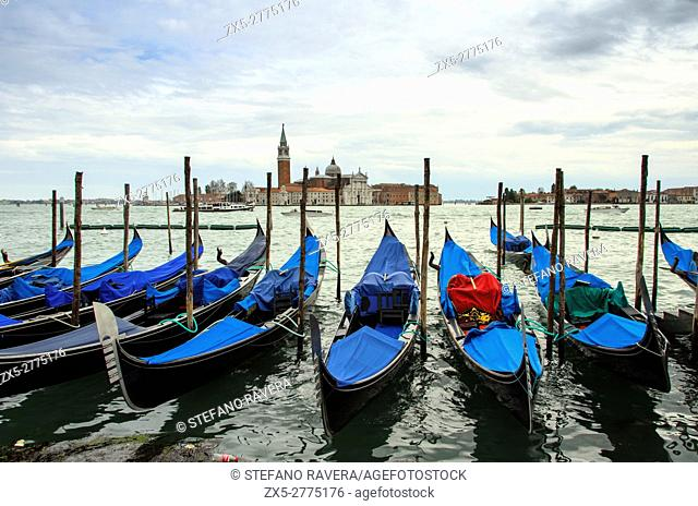 View of S. Giorgio Maggiore island and the Grand Canal with gondolas from San Marco square - sestiere San Marco, Venice - Italy
