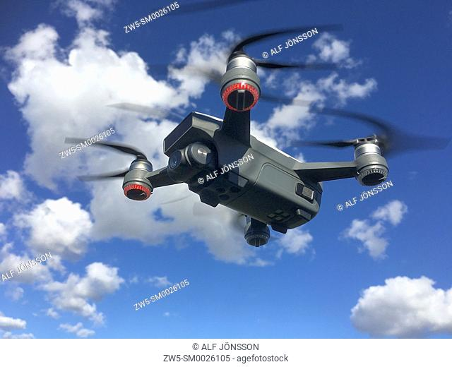 Flying quadrocopter, remote controlled drone with camera in Ystad, Scania, Sweden