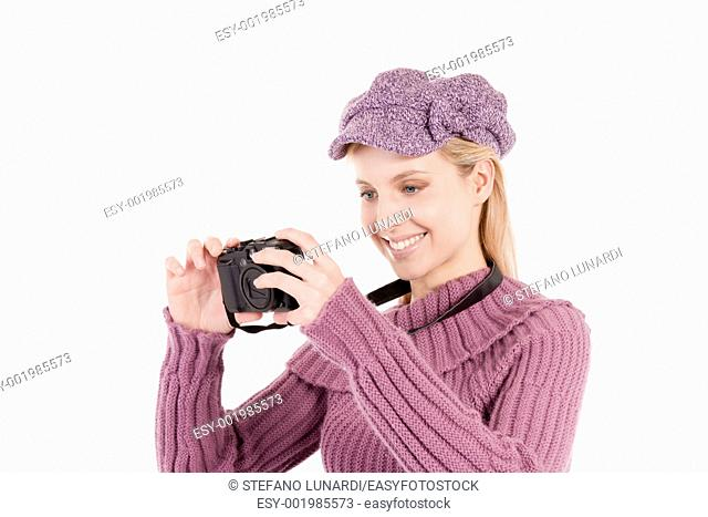 Beautiful young woman with camera, isolated on white