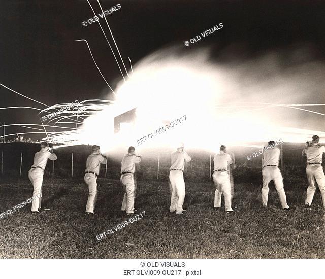 A demonstration of night sub-machine gun firing