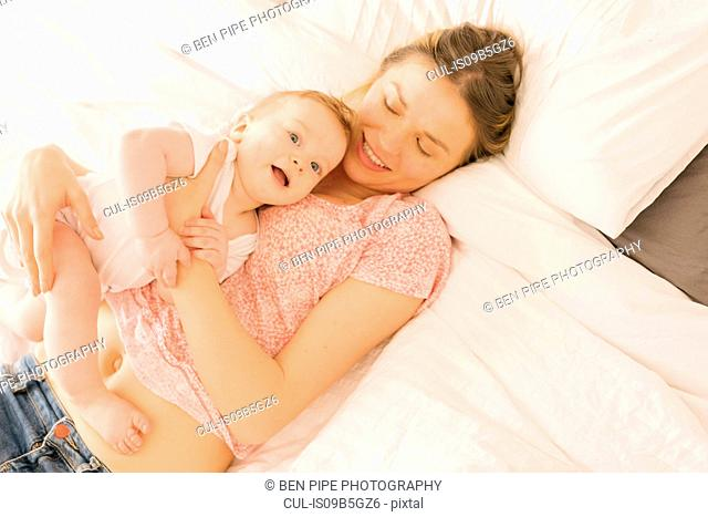 Mother and baby bonding on bed