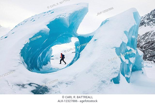 Man Skiing Near Frozen Icebergs In Winter, Knik Glacier, Southcentral Alaska, USA