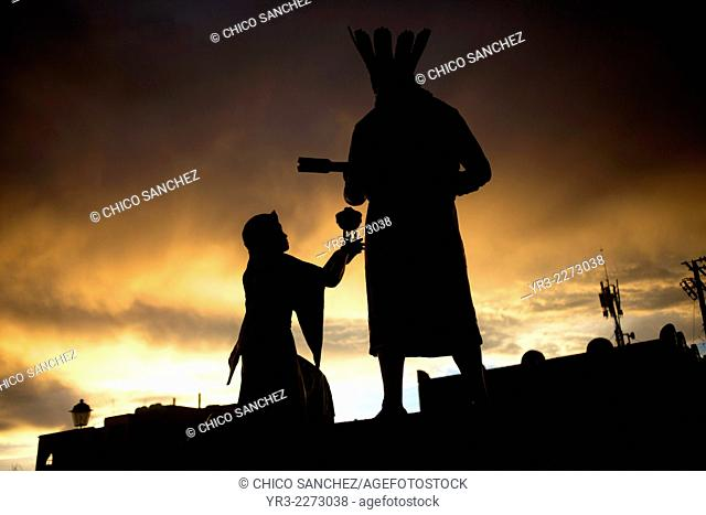 The silhouette of the monument to the Chichimeca native American indians is seen at sunset outside the Temple of the Saint Cross in Queretaro, Mexico