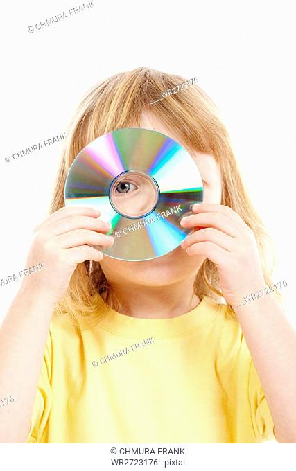 background, boy, cd, child, color, compact, data, disc, disk, DVD, holding, human, isolated, looking, male, one, people, person, shirt, showing, software
