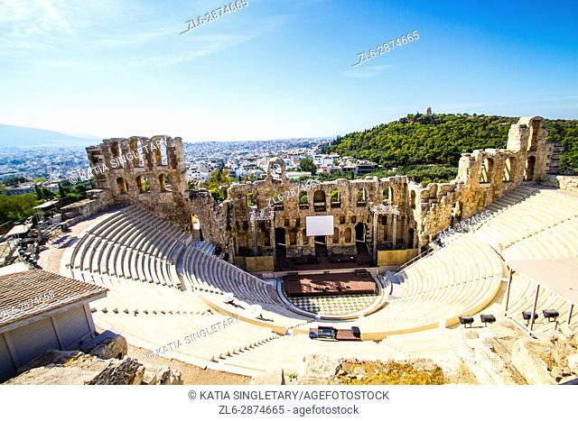 Beautiful view of the Theatre of Herodes Atticus from up top and the view of Athens behind it on a perfect plus sky and sunny day