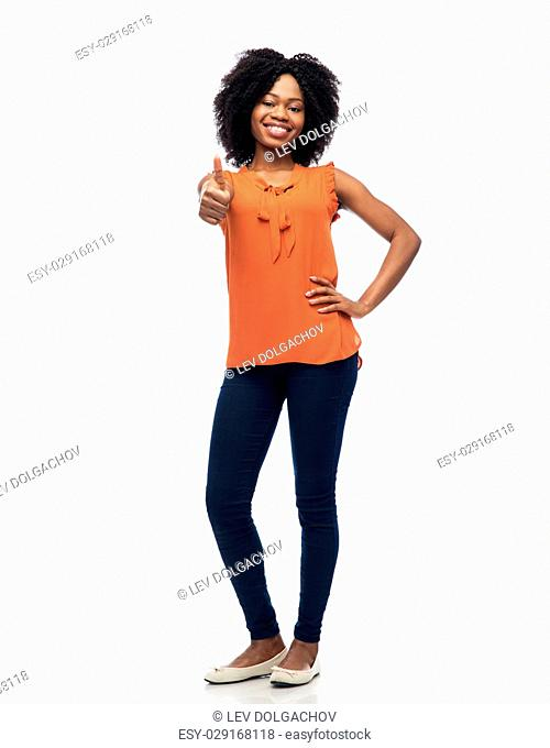 people, race, ethnicity and gesture concept - happy african american young woman showing thumbs up over white
