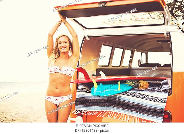 Beach Lifestyle, Beautiful Surfer Girl On The Beach At Sunset With Classic Vintage Surf Van