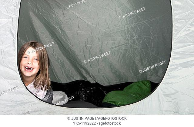 Shot of a Young Girl with a Big Smile in her Tent