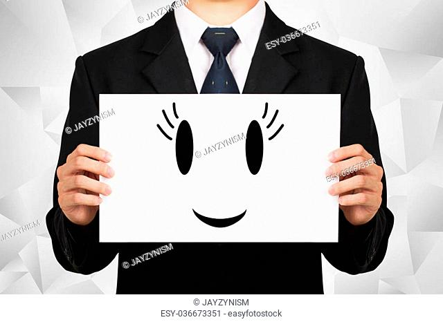 Businessman holding on whiteboard with icon smile