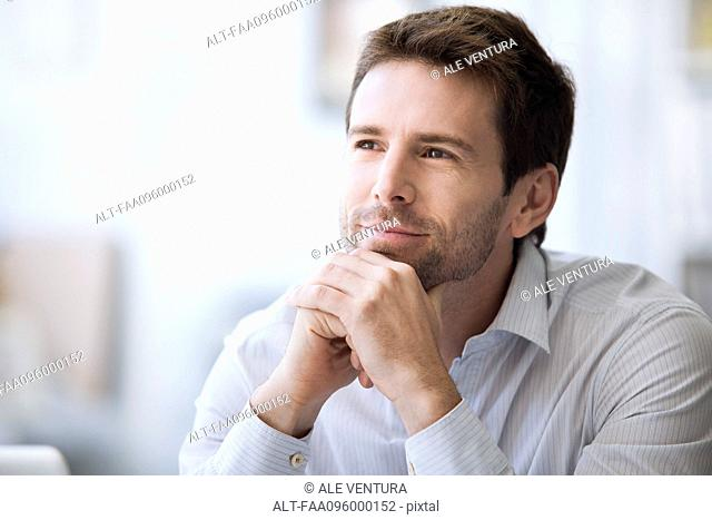 Mid-adult man in thought, portrait