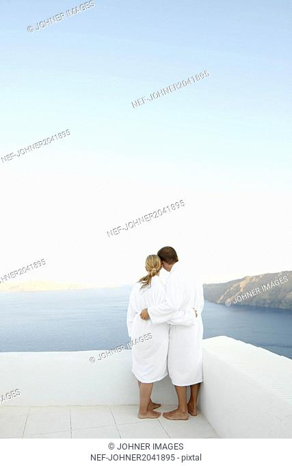 Couple hugging, sea on backgrounds