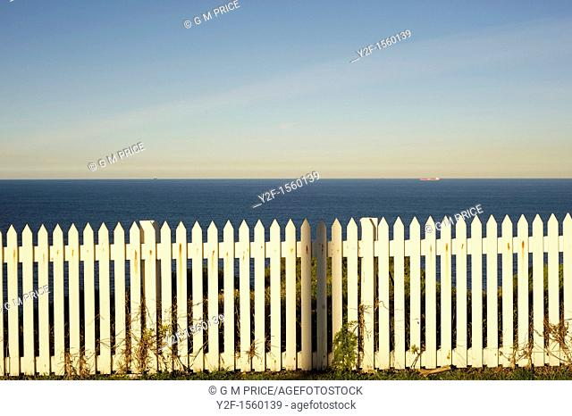 white picket fence by the sea