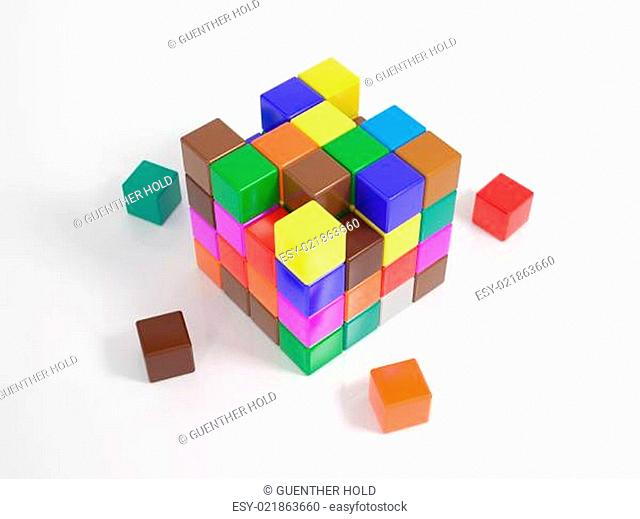 Many small cubes building a big cube
