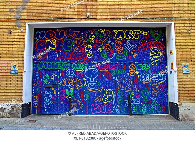 parking door with graffiti, Sant Cugat del Valles, Catalonia, Spain