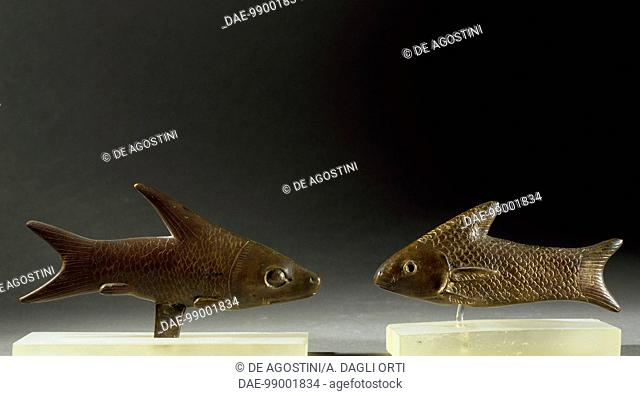 Figures of fish with magical-religious significance, bronze. Egyptian civilisation, Late Period.  Bologna, Museo Civico Archeologico (Archaeological Museum)
