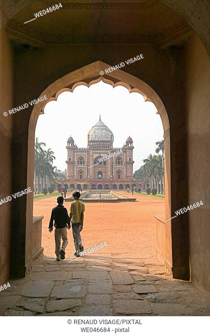 Kids entering 18th century Safdarjang's Tomb. New Delhi. India