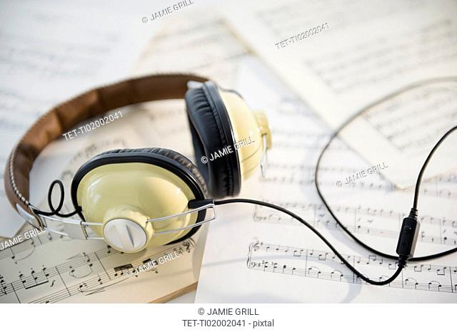 Headphones and music sheets