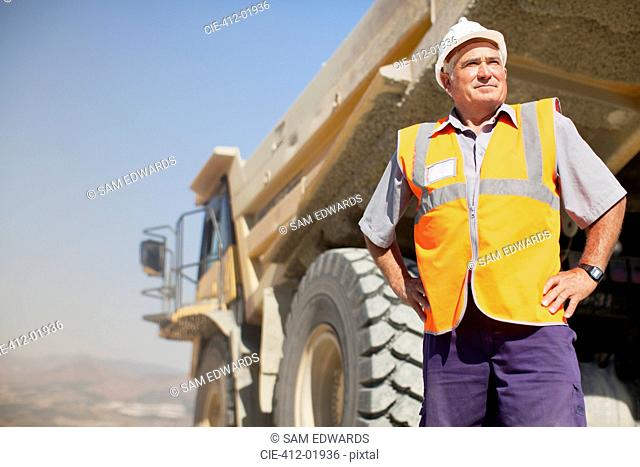 Worker standing by machinery on site