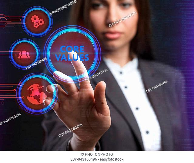 The concept of business, technology, the Internet and the network. A young entrepreneur working on a virtual screen of the future and sees the inscription: Core...