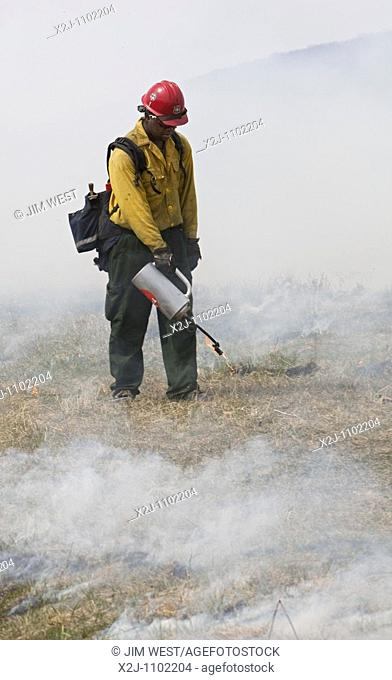 Shenandoah National Park, Virginia - Workers wearing fire resistant clothing intentionally burn Big Meadows  The National Park Service burns part of the meadow...
