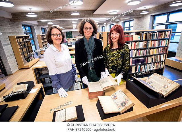 "Librarian Heike Mueller (L), Katja Conradi, from the Association Amici Bibliothecae Christianei (lit. """"Friends of the library of the Christianeum"""") and dean..."