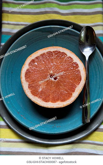 Sliced Grapefruit on Blue Plate