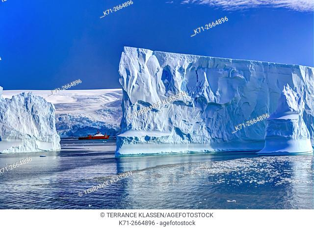 A supply ship with icebergs in Admiralty Bay, South Shetland Islands, King George Island, Antarctica