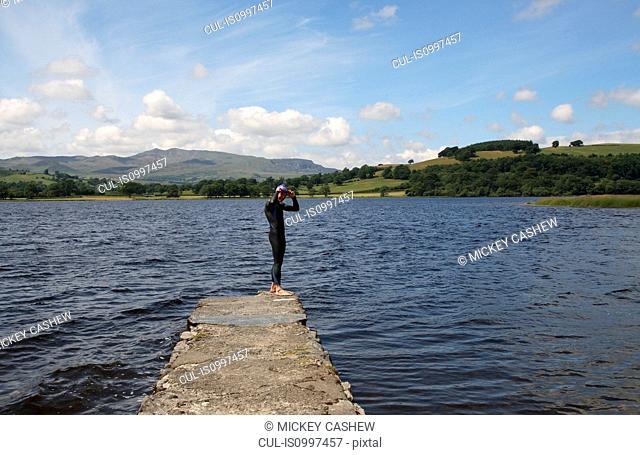 Triathlete swimmer standing on jetty