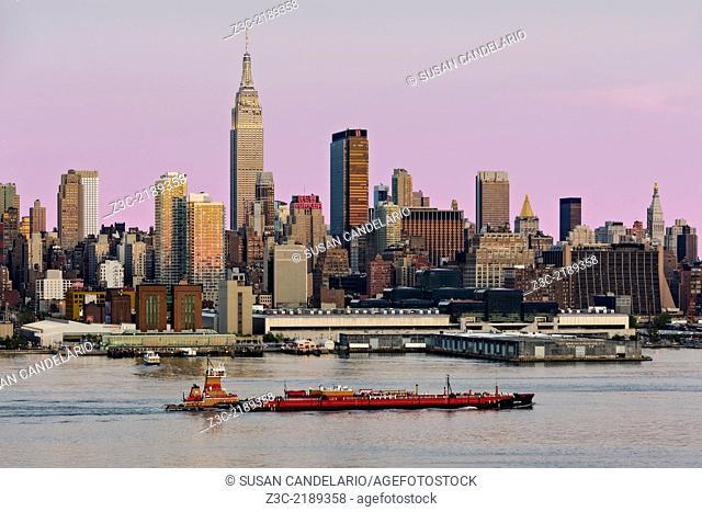 Articulated Tug and Barge (ATB) Reinauer Transportation Co. RTC 106 barge with the midtown Manhattan, New York City Skyline as a backdrop