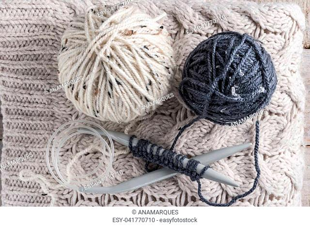 Vintage Knitting needles and yarn on wooden background/natural wool knitting background
