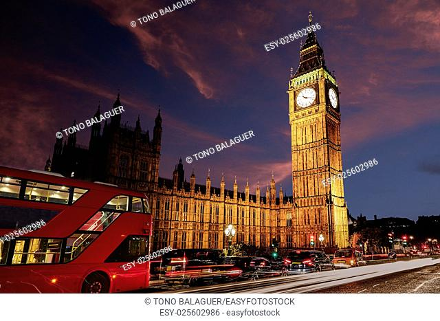 Big Ben Clock Tower with London Bus sunset in England
