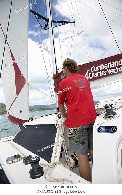 Man sailing in the Whitsunday Islands, Queensland, Australia