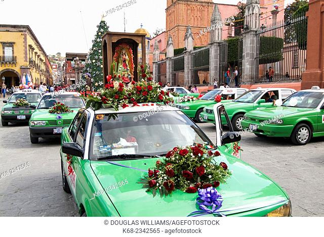 taxis decorated for the procession on the feast day of the virgen of Guadalupe in San Miguel de Allende, Mexico