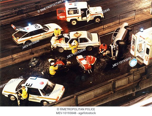 Metropolitan Police officers attend the simulation of a road traffic accident on the Harrow Road