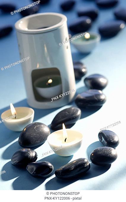 Candles, peebles and essential oil burner