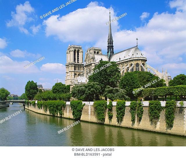 Notre Dame cathedral over urban canal, Paris, Ile-de-France, France