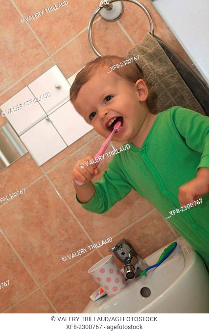 Karl, 2 years old brushing his teeth