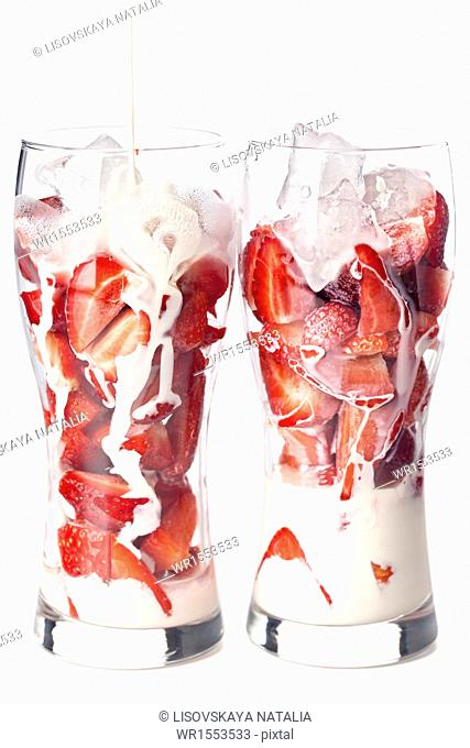 Strawberry with milk on white background