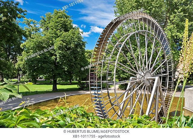 Park with sculptures in the Salingarden in front of the culture and congress center with the waterwheel of Josef Hamberger, Rosenheim, upper Bavaria, Bavaria