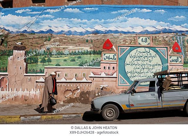 Africa, North Africa, Morocco, Atlas Mountains, Dades Valley, Boumalne Town, Painted Wall, Men
