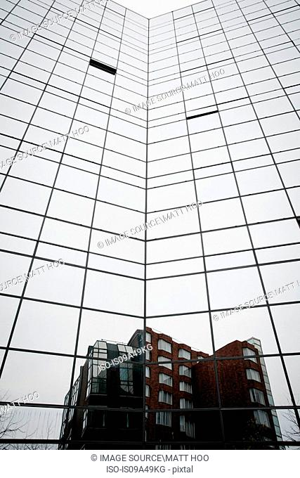 Building reflected in glass windows