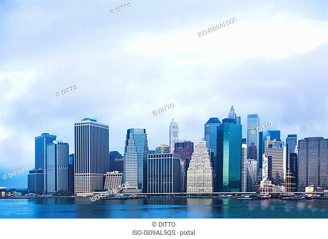 View of East river and Lower Manhattan skyline, New York, USA