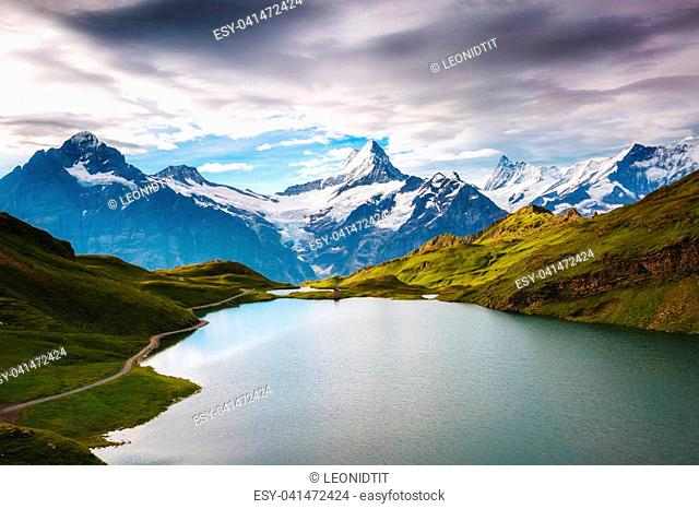 Panorama of Mt. Schreckhorn and Wetterhorn. Popular tourist attraction. Dramatic and picturesque scene. Location place Bachalpsee in Swiss alps