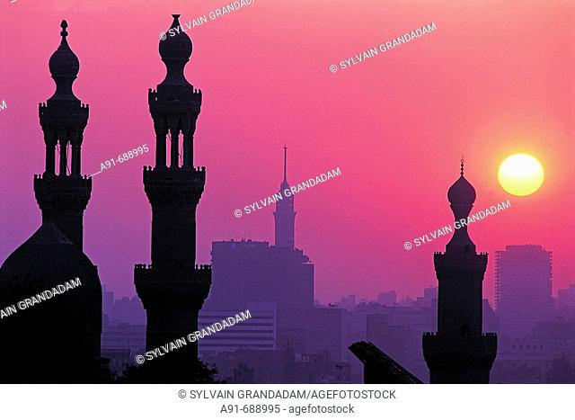 Minarets of Hassan mosque at sunset, view from citadel .City of Cairo. Egypt
