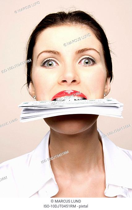 Woman biting bank notes