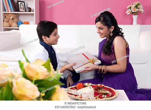 Sister giving gift to her brother at Raksha Bandhan