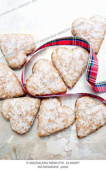 Heart-shaped gingerbread cookies with checkered ribbon
