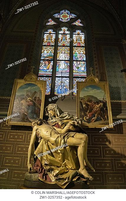 Stained glass windows, paintings and Pieta sculpture, St Peter and St Paul Basilica, Vysehrad Castle, Prague, Czech Republic